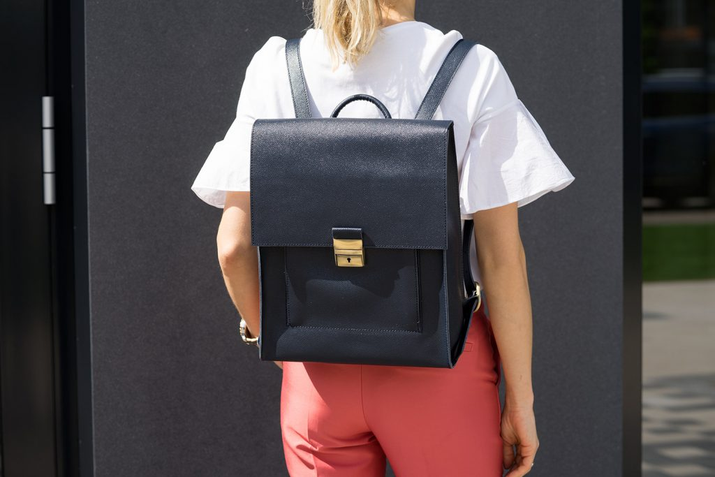 Blue Leather Backpack Briefcase Diana Florian Outside Gray wall background.jpeg