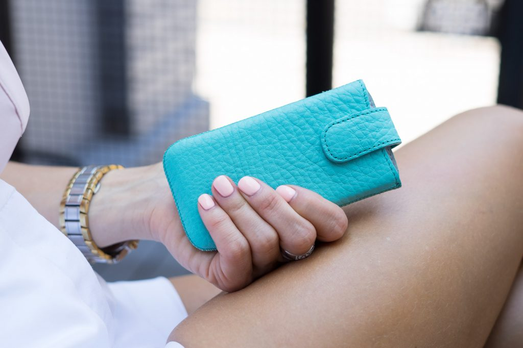 Turquoise iPhone 55s5cSE Leather Case in woman hands.jpeg